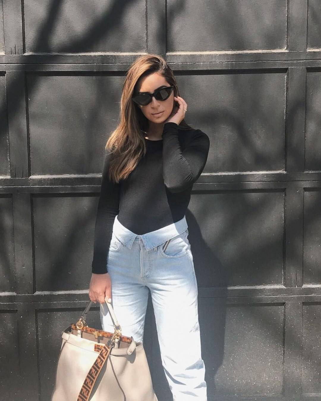Spring Basic Outfit: Black Bodysuit And Blue Jeans 2019