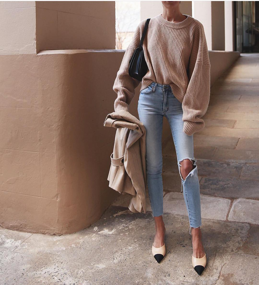 Oversized Camel Sweater And Slim Blue Jeans Are Spring Essentials 2019