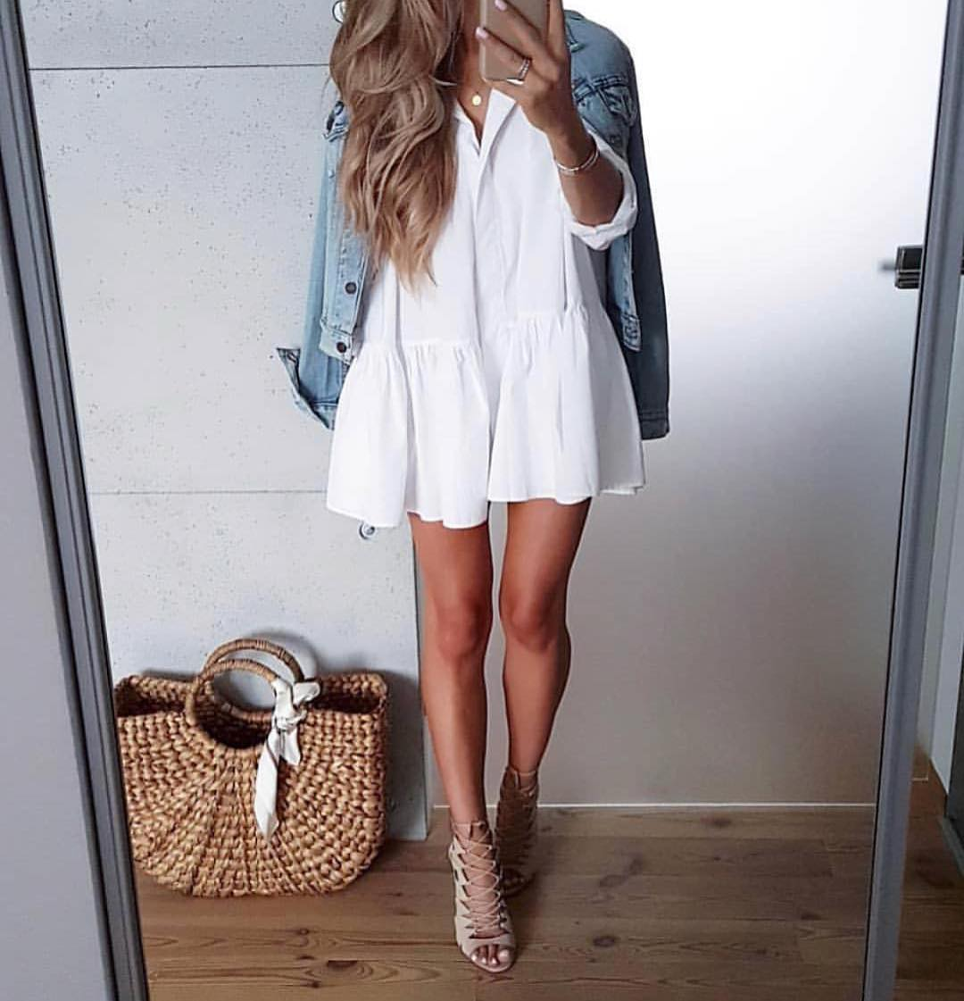 White Peasant Dress With Denim Jacket And Strappy Heeled Sandals For Summer 2020