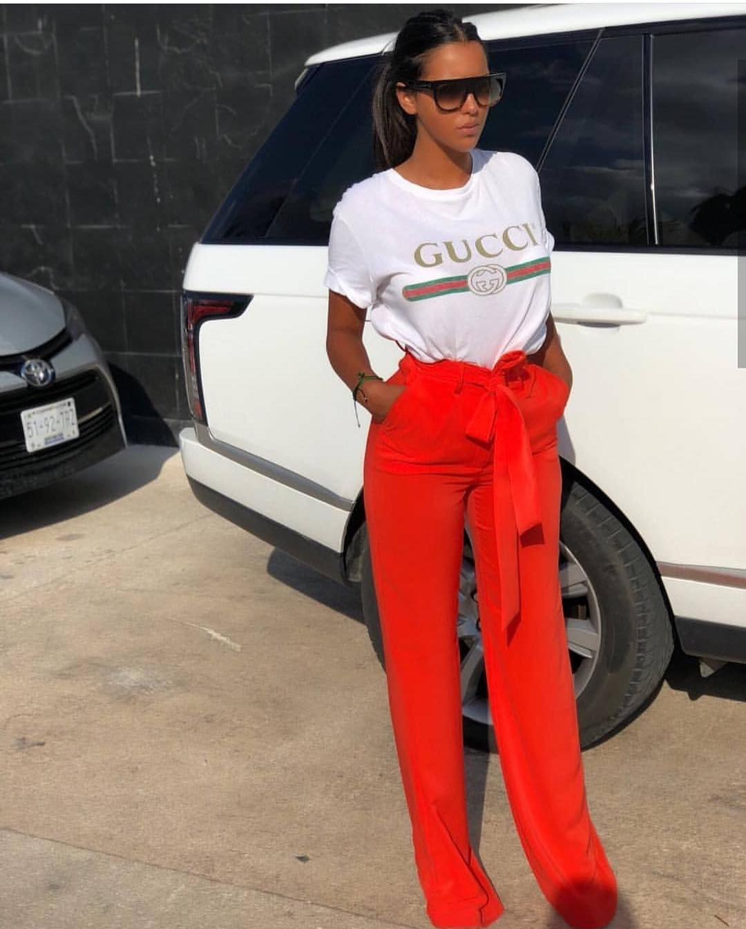 White T-Shirt Tucked In Red Wide-Leg Pants For Summer 2019