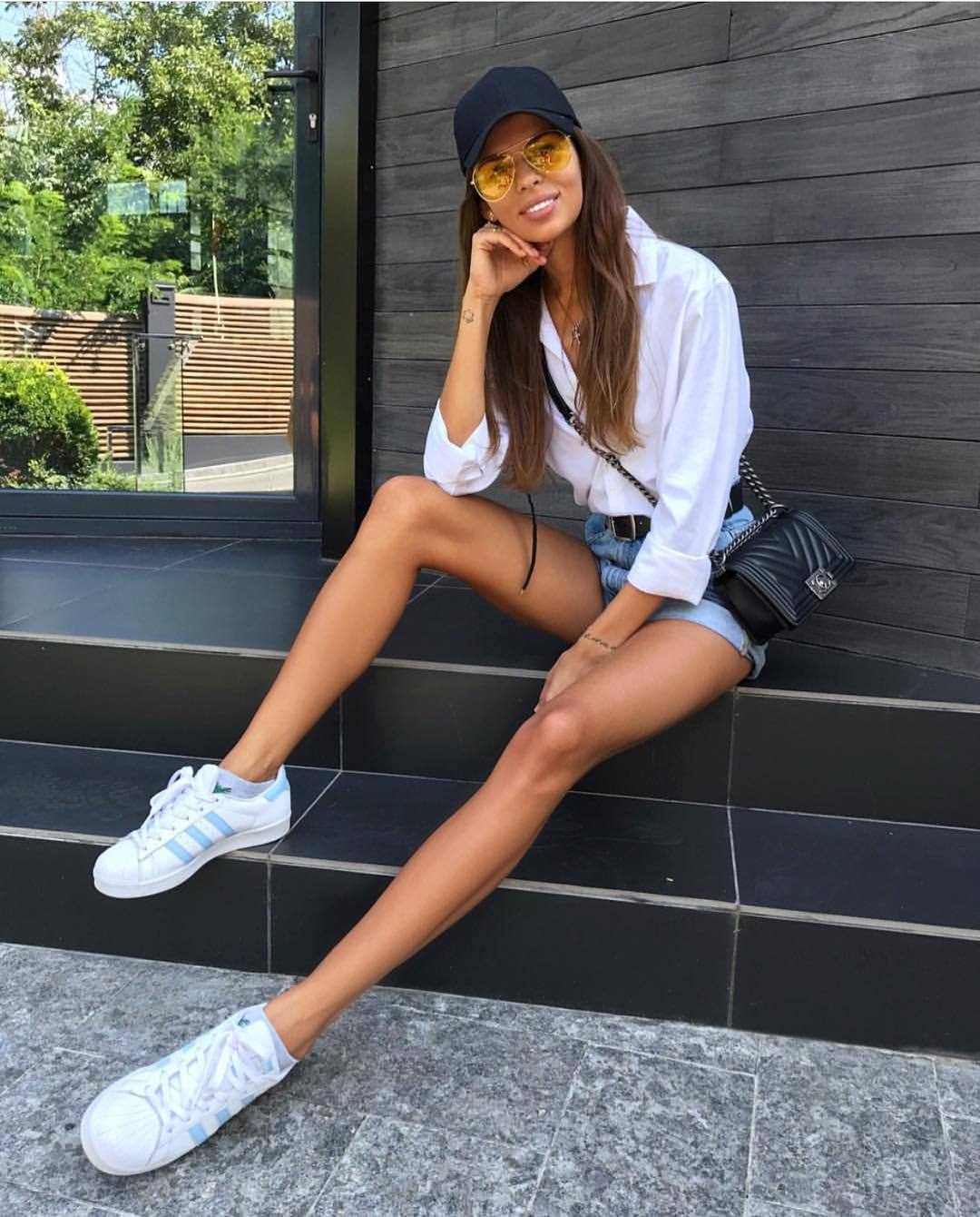 White Shirt, Blue Denim Shorts And White Sneakers For Summer Casual Walks 2019