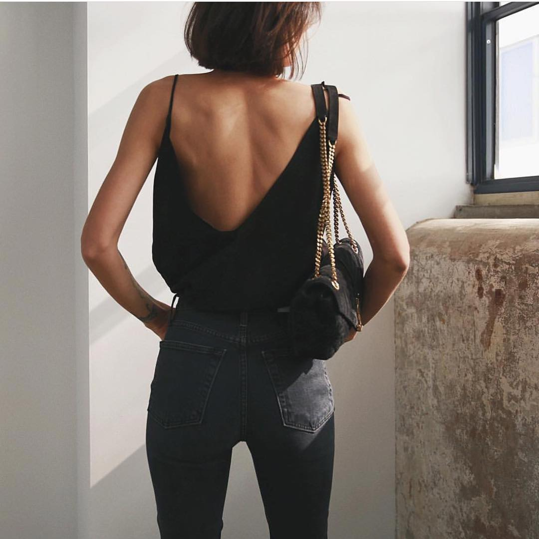 Wide Open Back Spaghetti Strap Slip Tank Top In Black Tucked In Black Jeans 2020
