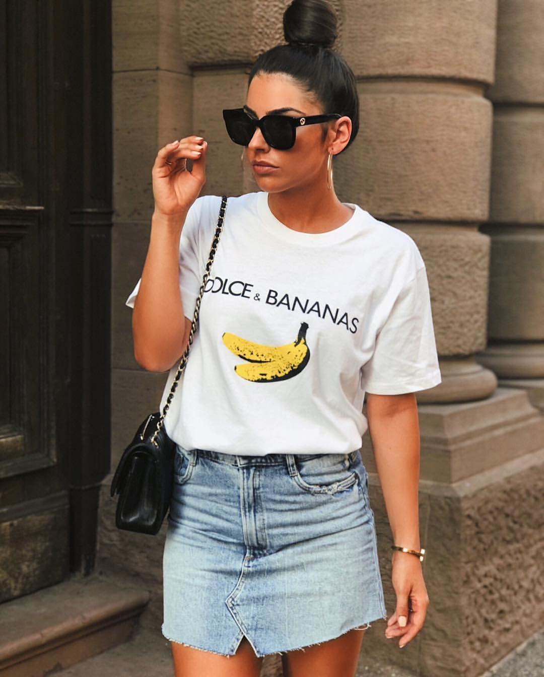 White T-Shirt With Graphic Print Tucked In Short Wash Blue Denim Skirt For Summer 2019