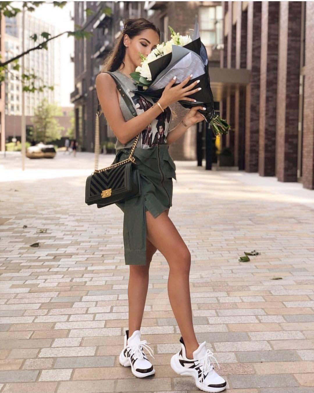 Grey Tank Top With A green Army Jacket Worn As A Skirt For Summer 2019