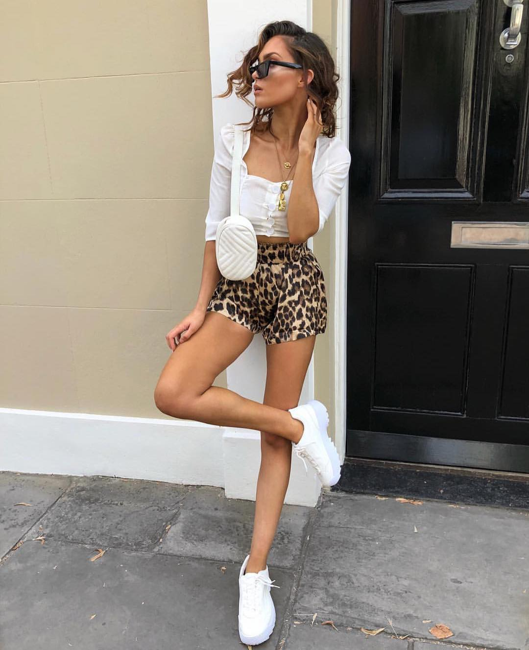 Summer Street Look: White Crop Blouse, Leopard Shorts And White Kicks 2021