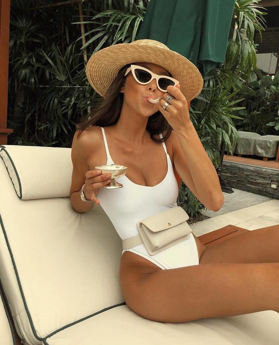 White Swimsuit And Cat-Eye Sunglasses For Getaway Summer Trips 2020