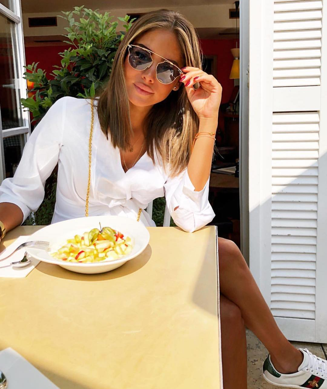Crispy White Wrap Dress With White Sneakers And Cat Eye Sunglasses 2019