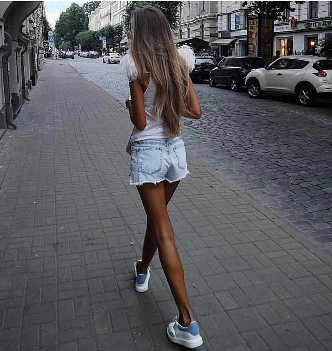 White Tank Top And Denim Cut Offs With White Chunky Sneakers For Summer 2019