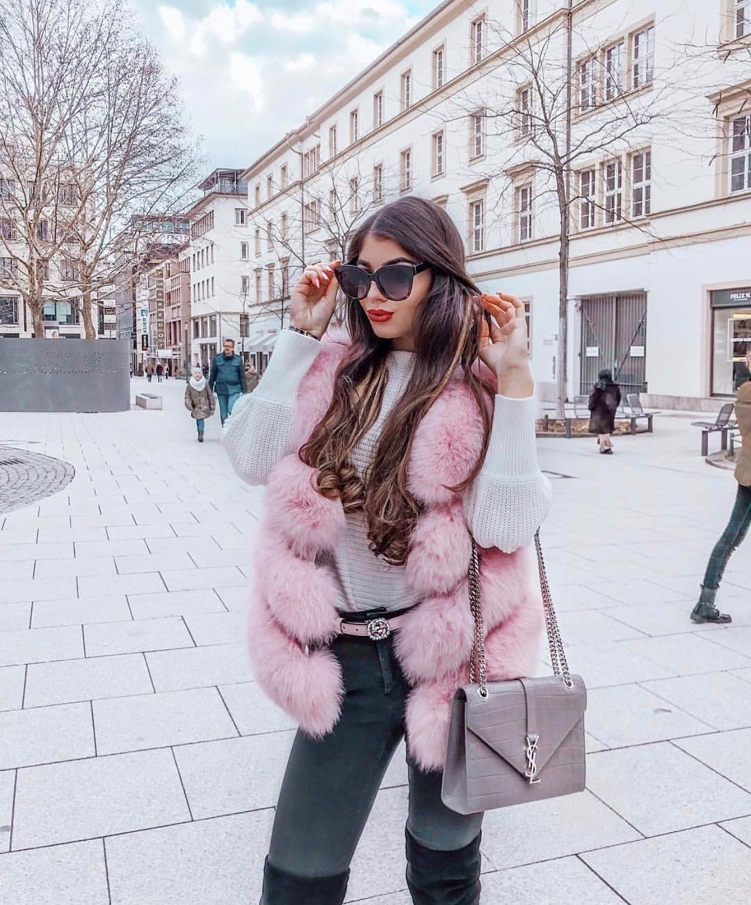 Pink Fur Vest And White Sweater With Grey Skinny Jeans For Winter 2019