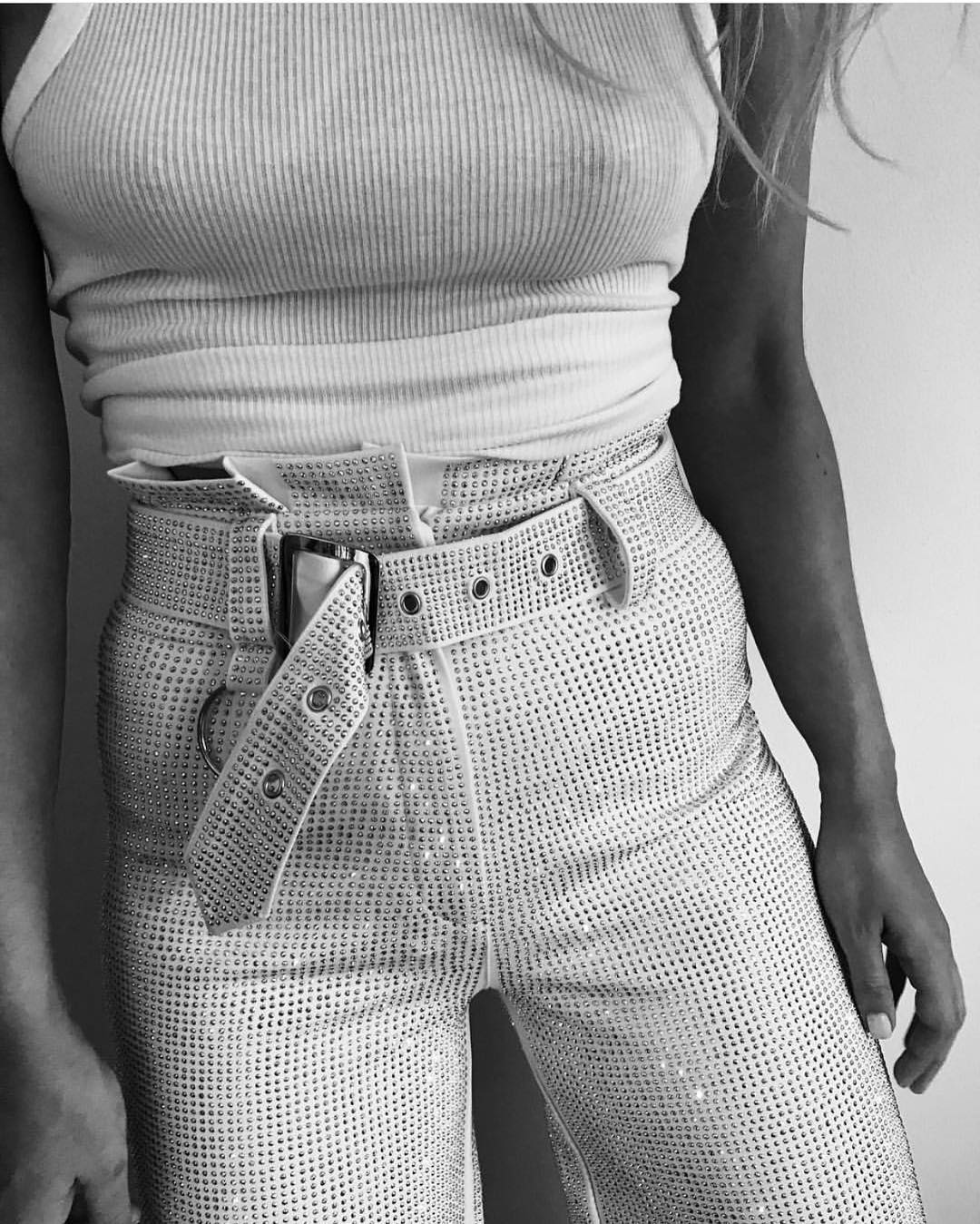 All Over Studded High-Rise Pants In White With White Tank Top For Summer 2019