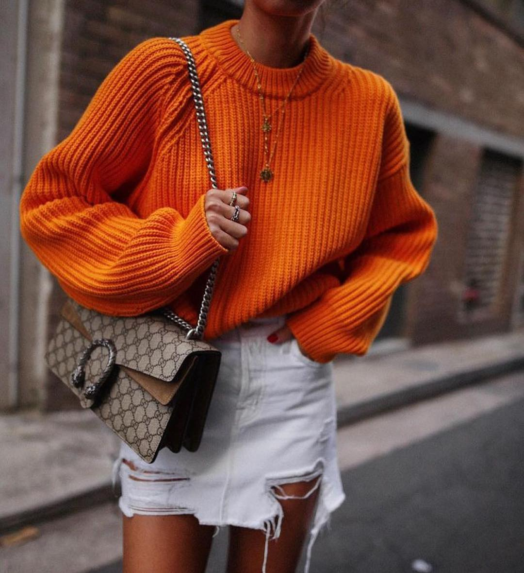 Can I Wear Bright Orange Sweater With Frayed Denim Mini Skirt 2020
