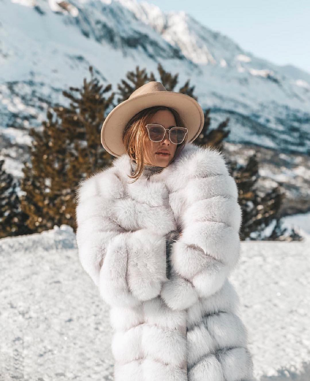 White Fur Coat With Oversized Cat-Eye Sunglasses And Cream Fedora Hat 2019