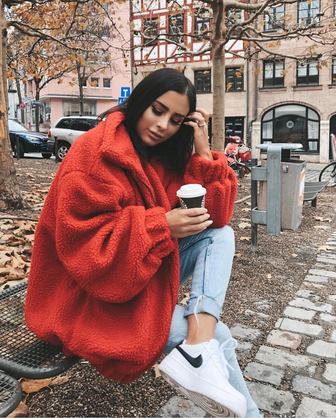 Oversized Red Teddy Bear Coat And Cuffed Blue Jeans With White Sneakers For Fall 2020