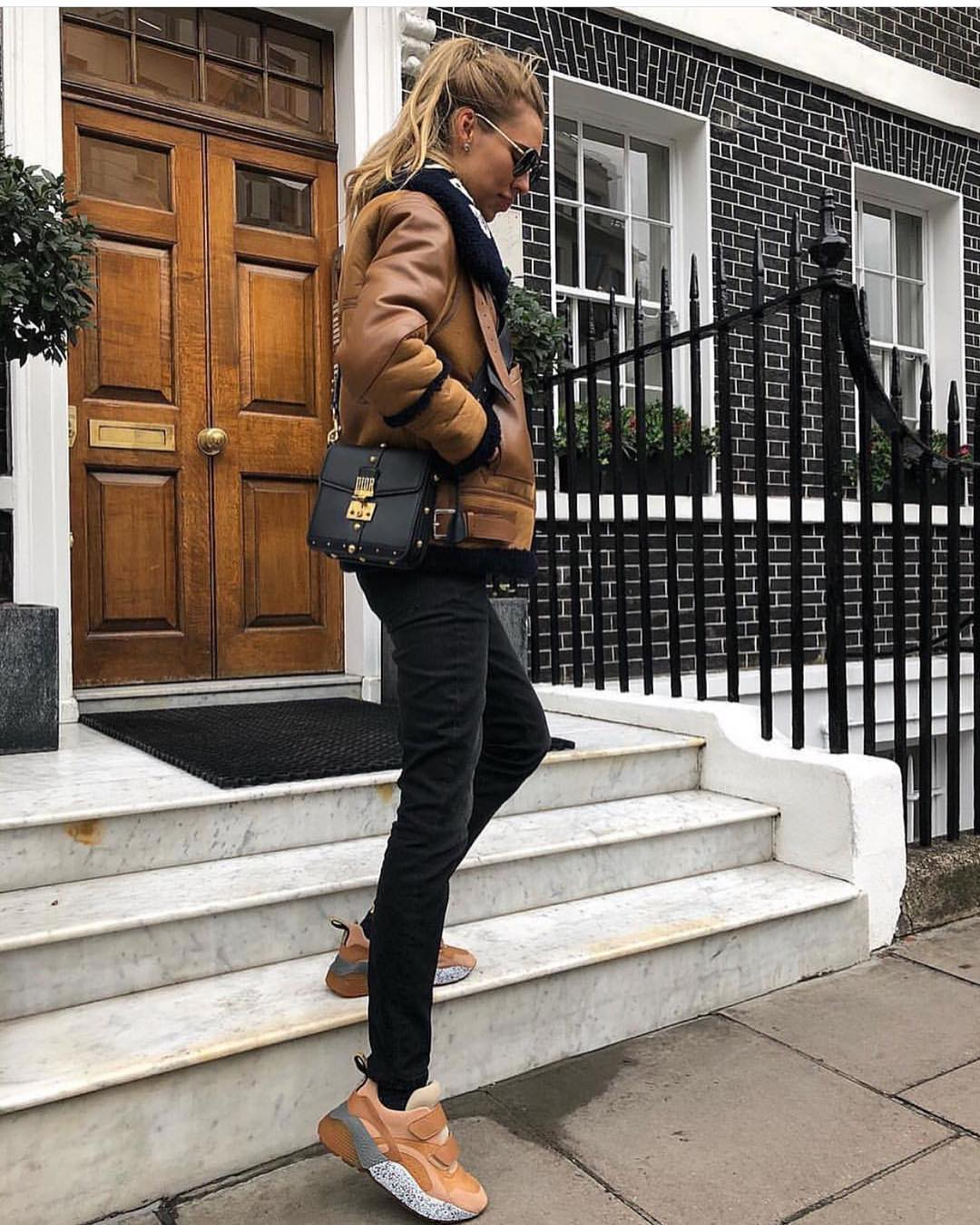 Brown Leather Aviator Jacket And Black Skinny Jeans With Pastel Orange Sneakers For Fall 2019
