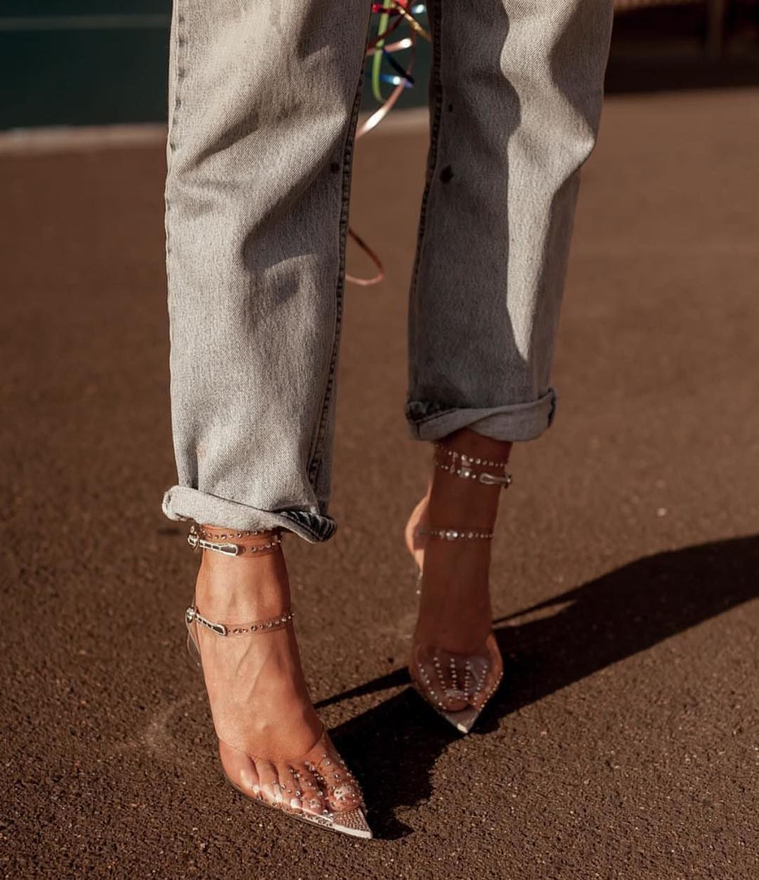 Clear Pointy Toe Heels And Cuffed Boyfriend Jeans For Spring 2021